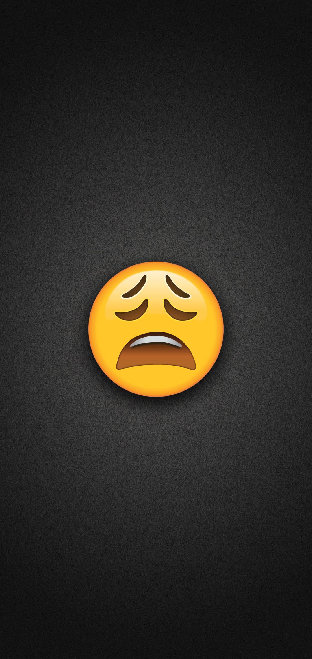 Tired Face Emoji Phone Wallpaper
